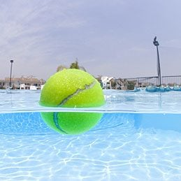 Fun things to do with a tennis ball: Keep a pool oil-free
