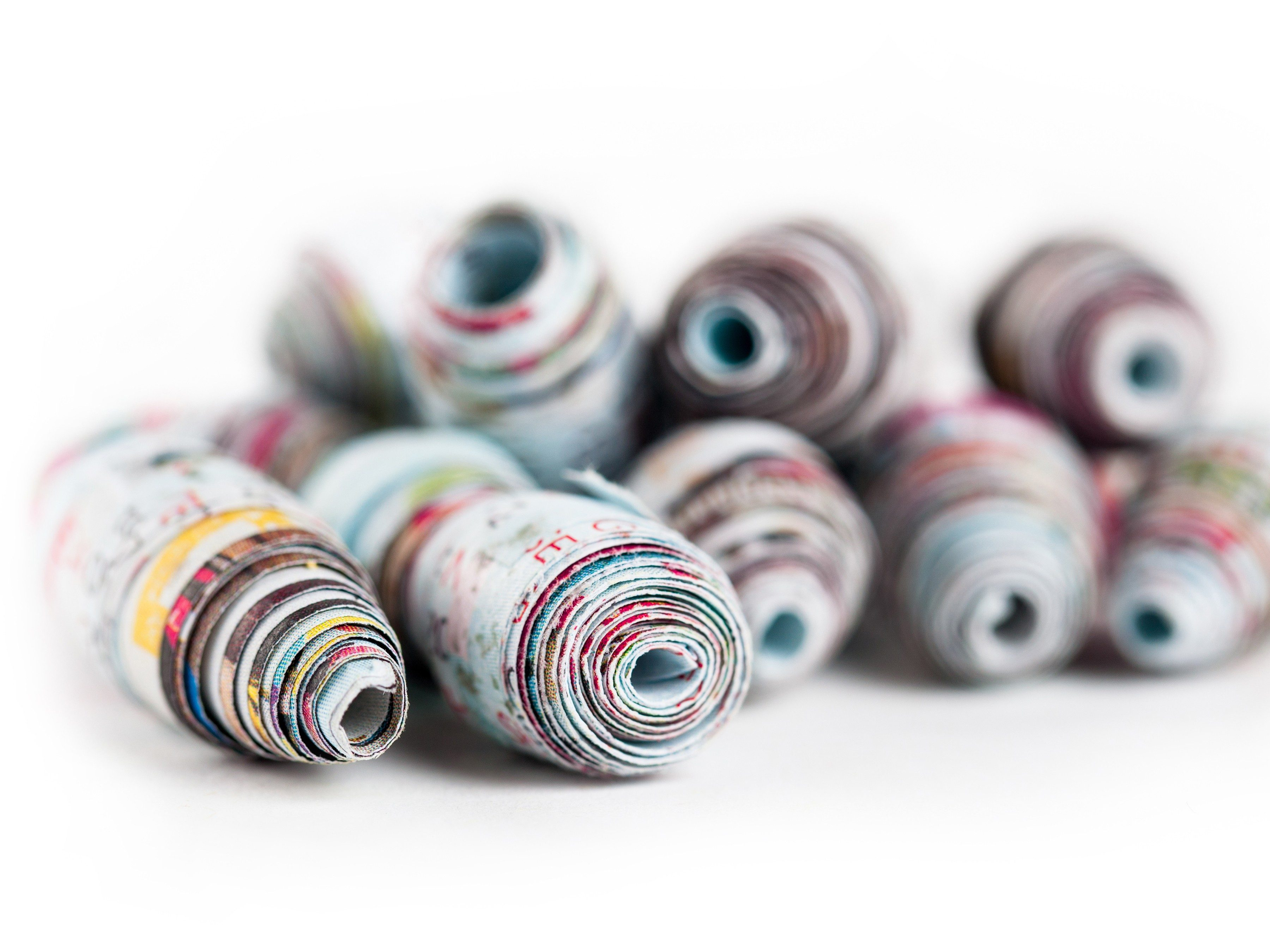 Make paper beads out of old magazines