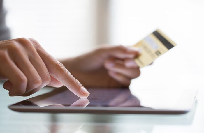 Person paying bills with credit card