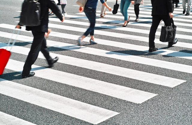 Young professionals crossing the street