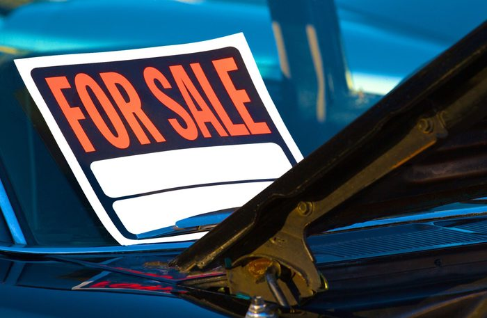 For sale sign on car windshield
