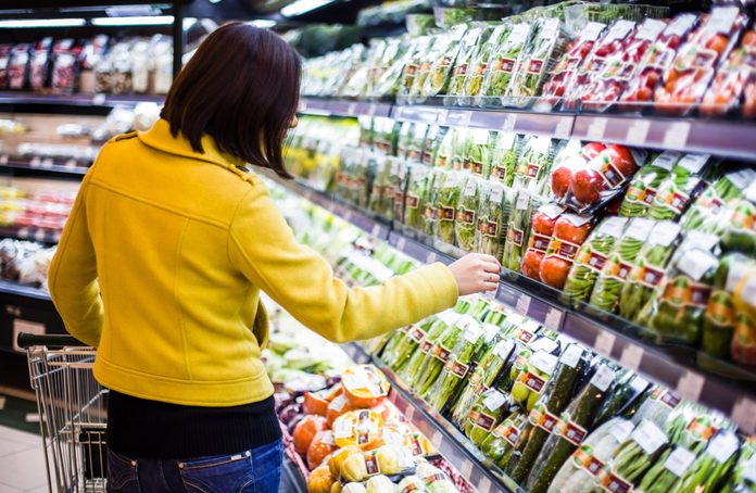 Woman looking at produce at the grocery store