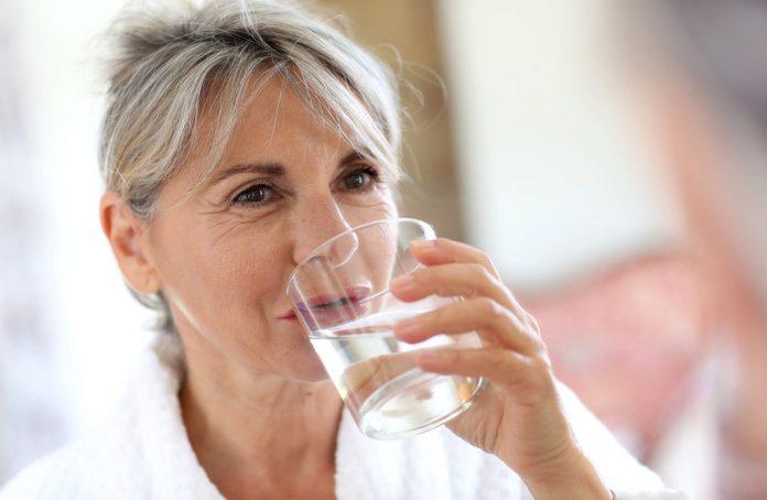 Elderly woman drinking water
