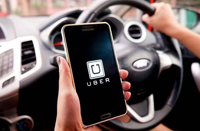 Person using Uber on smartphone