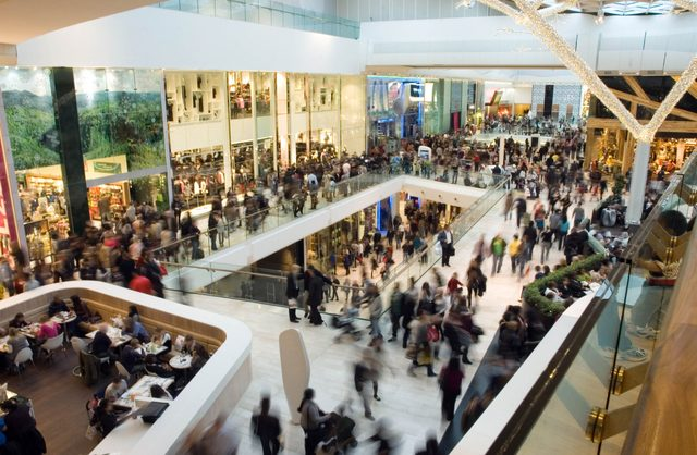Interior of busy shopping mall