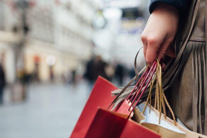 Woman carrying multiple shopping balls
