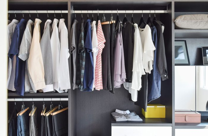 Closet filled with shirts