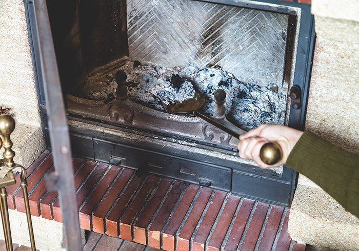Person cleaning fireplace
