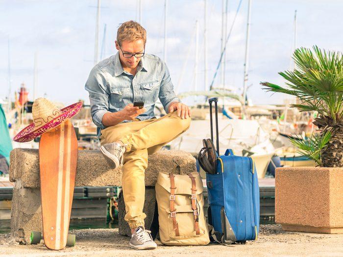Man on vacation checking his phone