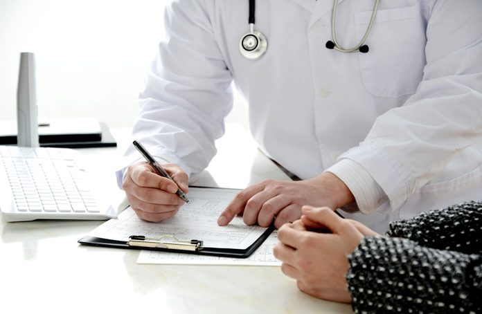 Doctor explaining diagnosis to patient