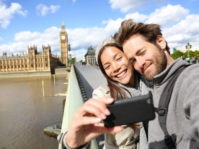 Couple taking a selfie at Westminster Palace in London