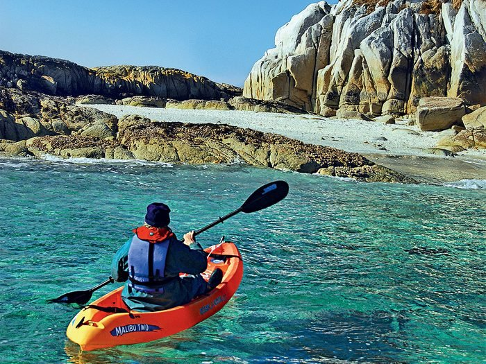 Kayaking along the shores of British Columbia's Calvert Island