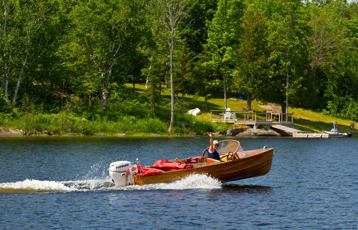 Woman takes her cedar strip boat to the cottage