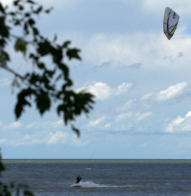 Man kitesurfing at the cottage