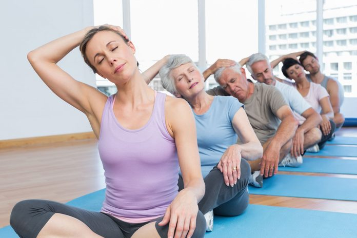 Elderly people at yoga class