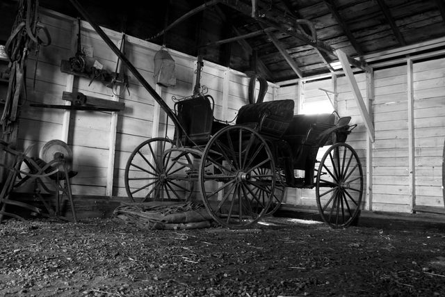 Old buggy in barn