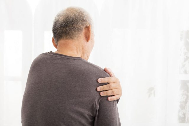 Man holding his arm in pain