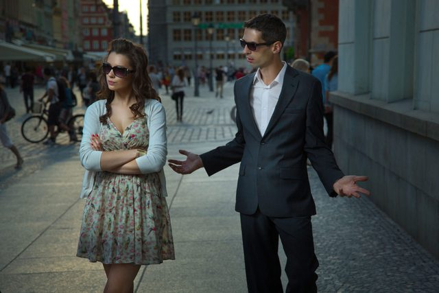 Couple arguing in street