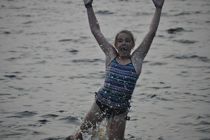 Child playing in Brereton Lake, Whiteshell Provincial Park in Manitoba