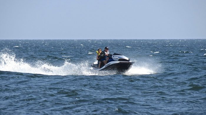 Father and son jet skiing