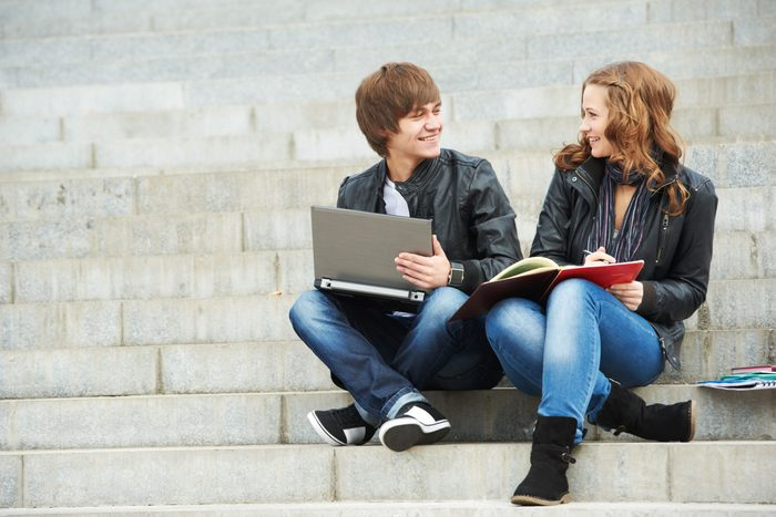 Two students happily studying