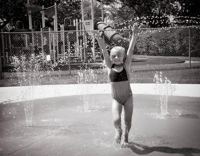 Little girl making a splash