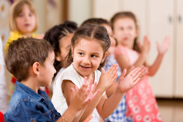Children playing in kindergarten class