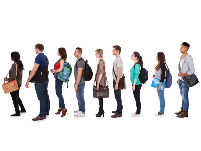People standing in line with back pain