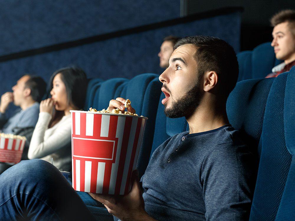 Surprised man in movie theatre