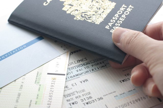 Canadian passport and boarding pass