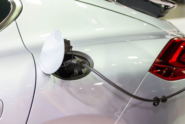 Electric car plugged into charger