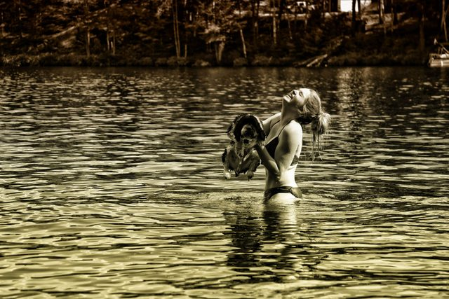 Dog and woman in lake
