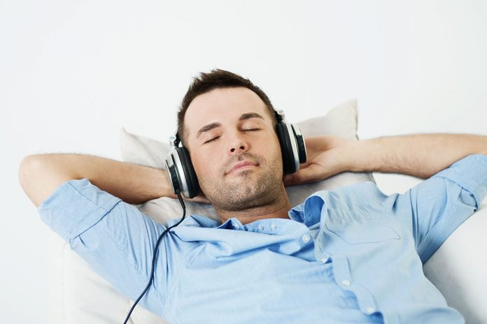 Man sleeping with headphones