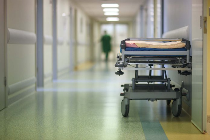 Hallway of hospital with cot