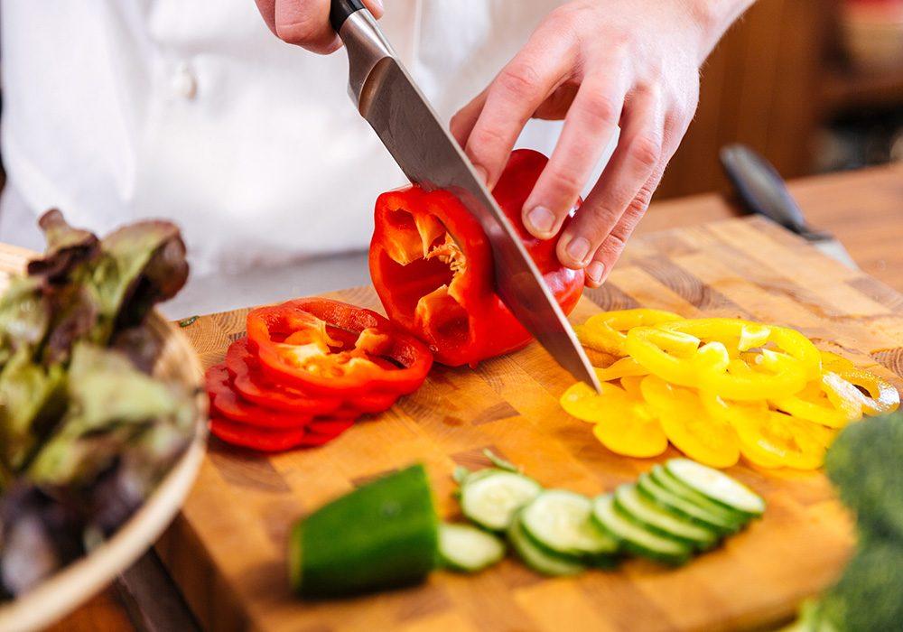 Chef preparing vegetables for salad