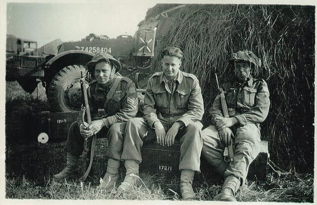 Old World War II photo featuring three soldiers for Remembrance Day