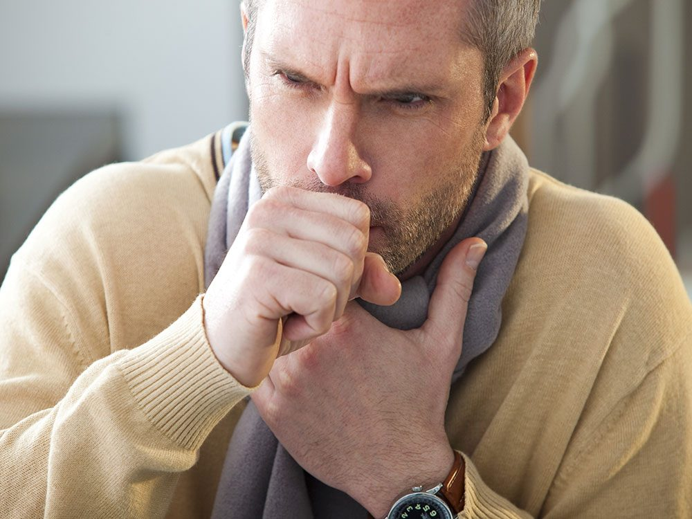 Middle-aged man coughing