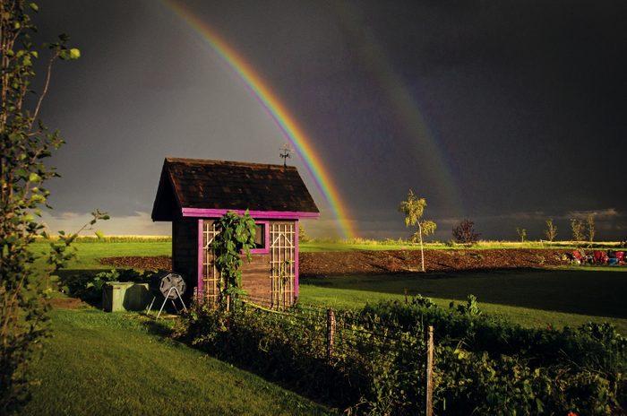 Rainbow across open field