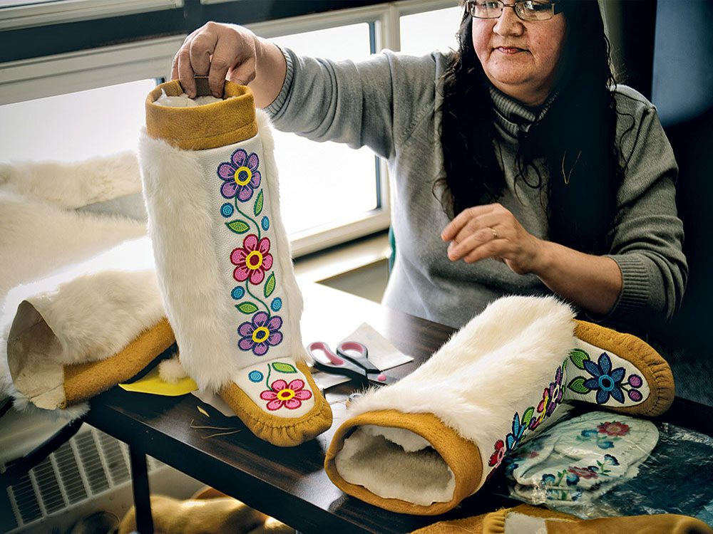 Woman making mukluk boot