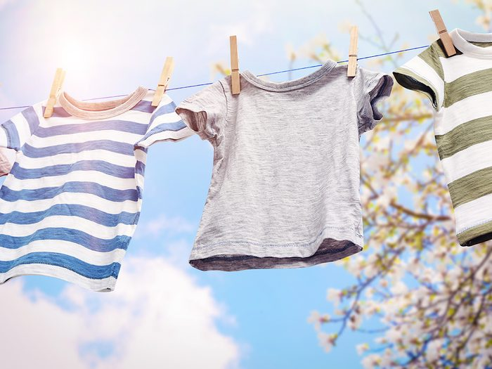 Energy saving guide - Rope with clean clothes outdoors on laundry day