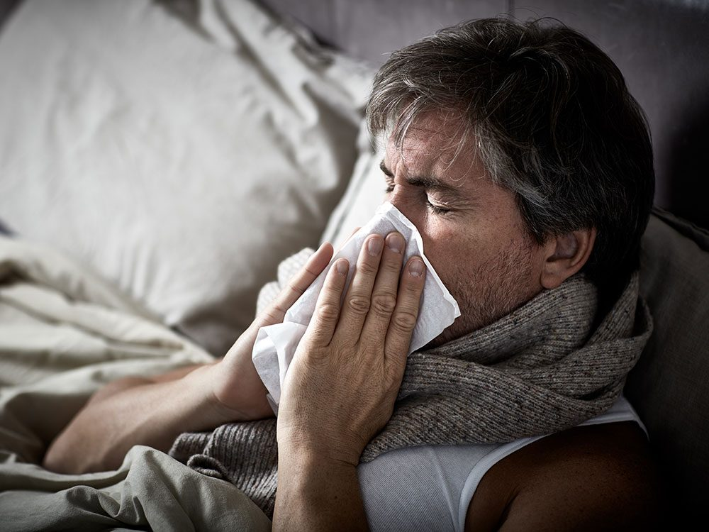 Man suffering with flu