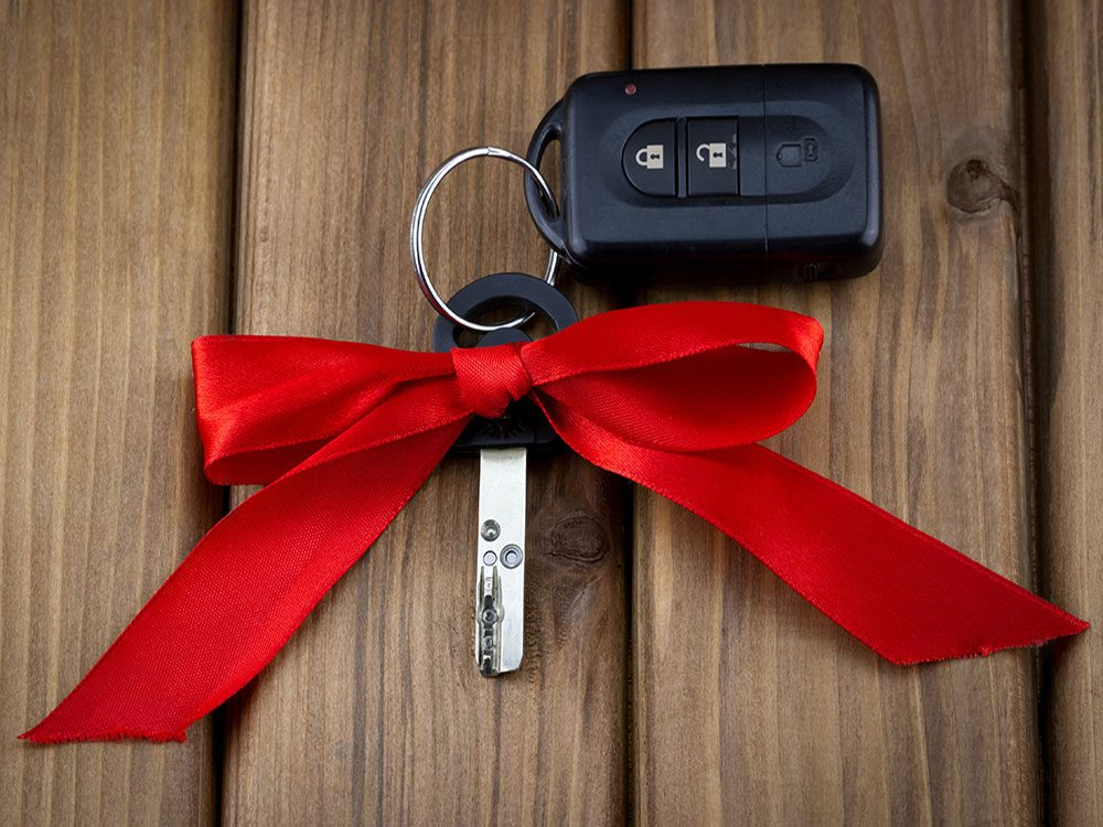 New car keys with red ribbon