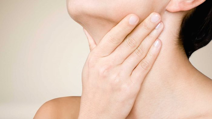 Woman with sore throat