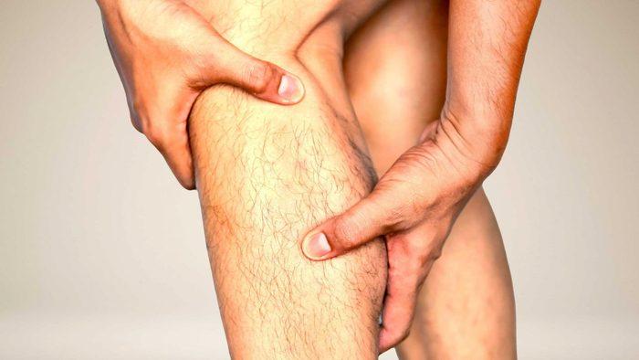 Man with leg cramp