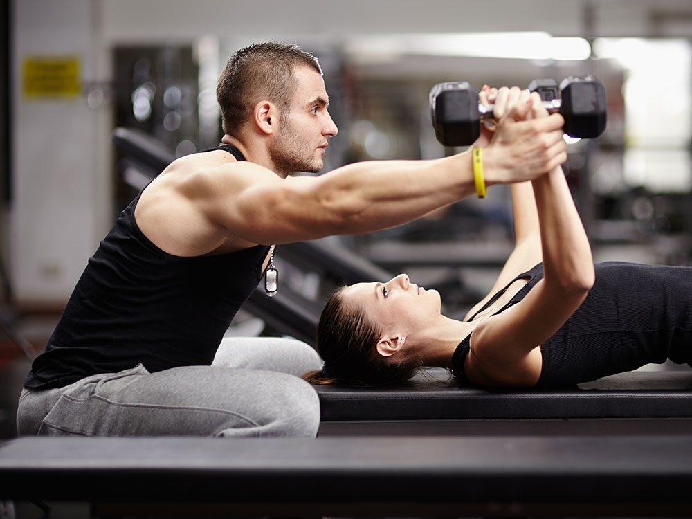 Trainer with woman working out