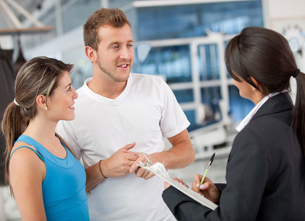 Gym members talking to manager