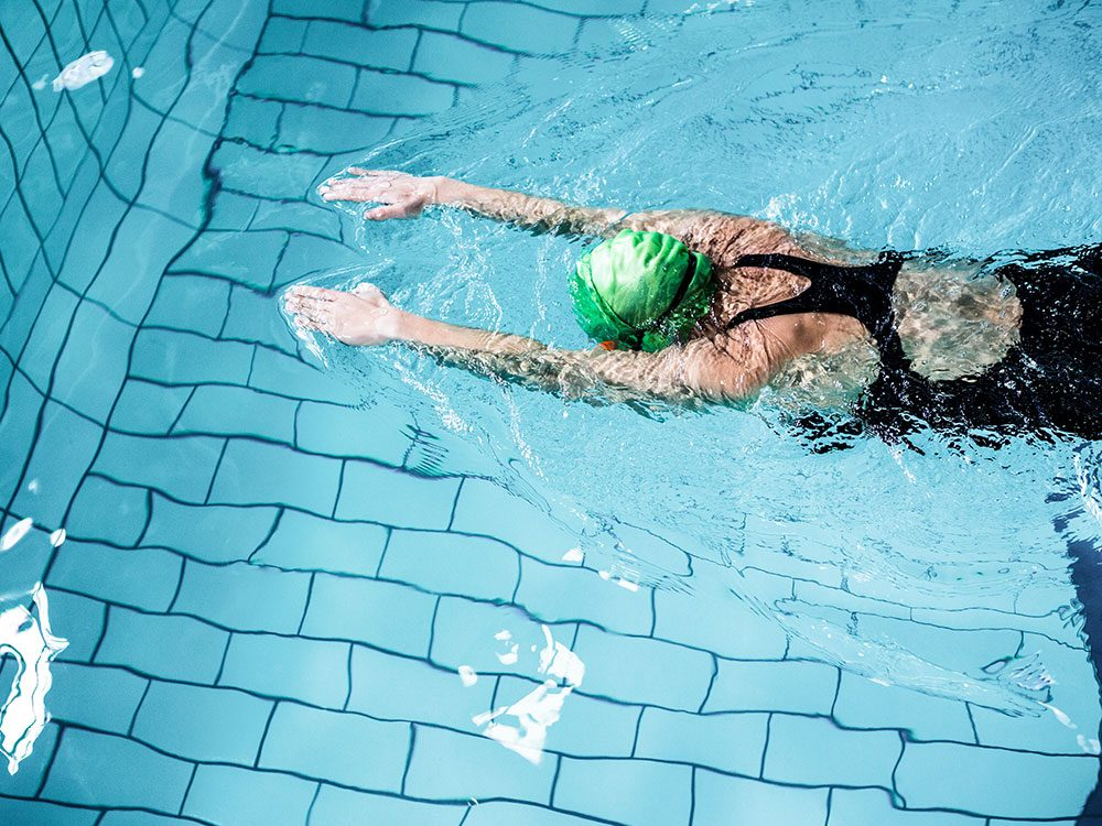 Woman freestyle swimming