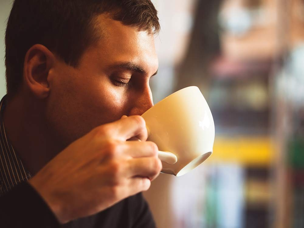 Man drinking tea in cafe