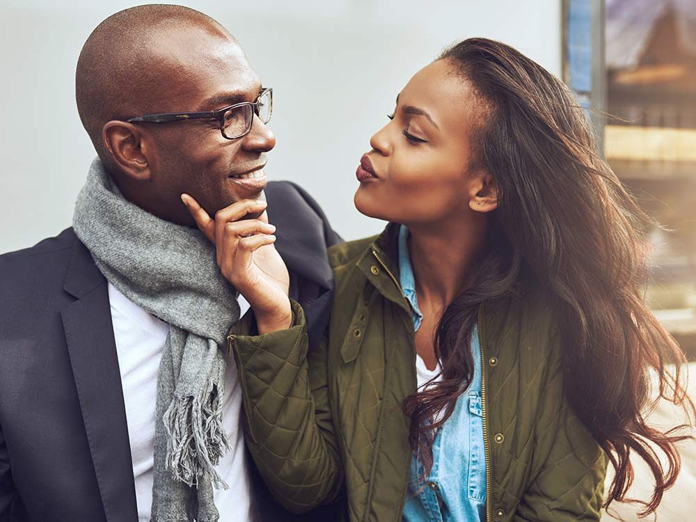 Woman about to kiss man