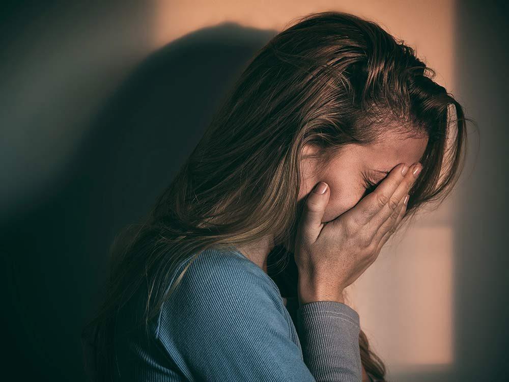 Woman exhibiting burnout signs